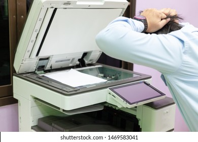Men press the button of the copier. Man copying paper from Photocopier. Men use printing machines. The concept of using a copier or paper printer.