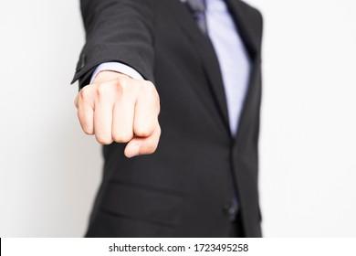Men punching shot in the studio