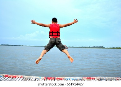 Men put on a life jacket to jump into the lake