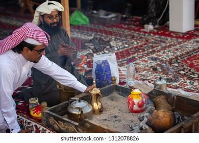 Men from Qatar prepare traditional Arabic tea and coffee, Doha, Qatar, December 09, 2014