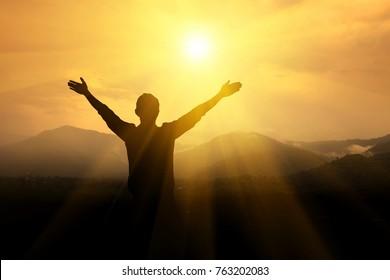 Men raise their arms up the sky. Thank God