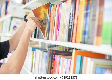 Men are reading books in the library.