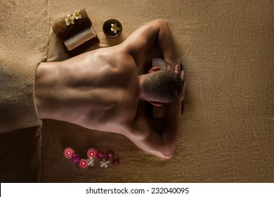 Men is ready for massage. Spa treatments