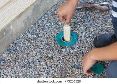 Men are replacing termite bait.Anti Termite Baiting System: