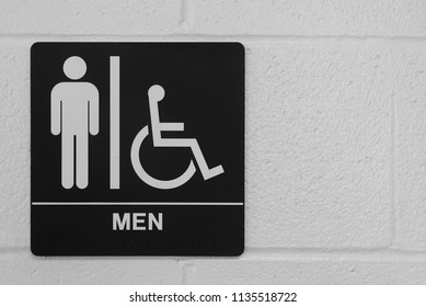 Men restroom sign on a white wall