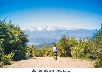 Men riding a bike at Cerro Catedral, Bariloch - Patagonia, Argentina.