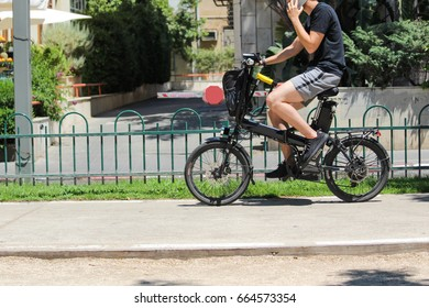 A men riding an electric bicycle in the city