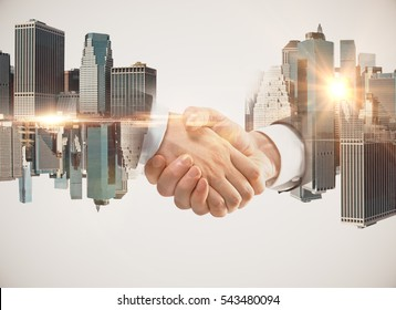 Men shaking hands on abstract city background. Double exposure. Teamwork concept