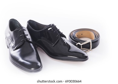 Men shoes collection - shoes and belt on a white background