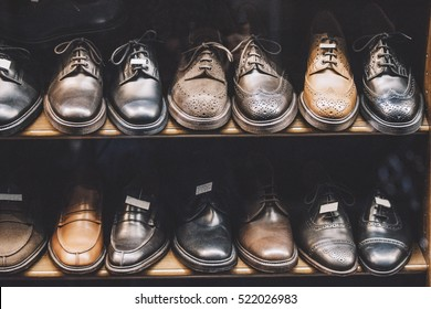 dac52a320f44 Men shoes in a luxury store