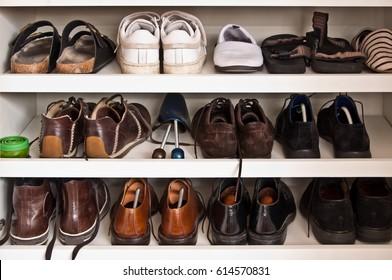 Men shoes on shelves in a closet