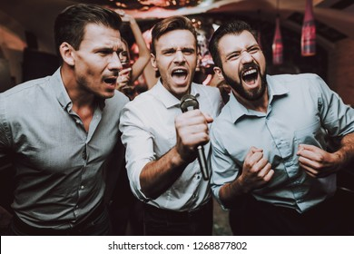 Men Sing. Boys. Great Mood. Young People. Dance Club. Sing. Microphone. Trendy Modern Nightclub. Party Maker. Birthday. Karaoke Club. Celebration. Handsome Men. Beautiful Girls. Dancing People.