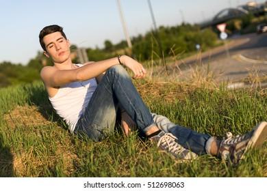 men sitting in a field in the grass
