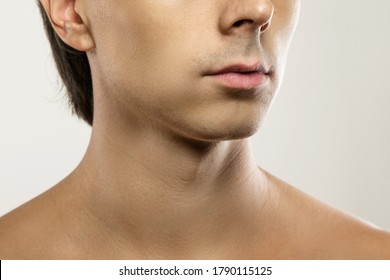 Men skin care and beauty. Closeup of clean-shaven male face.