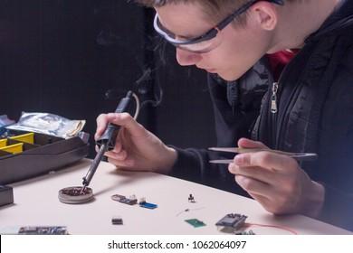 a men soldering parts