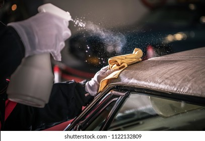 Men Spraying Vinyl Protectant For the Convertible Car Soft Roof.