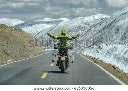 Men standing on motorbike