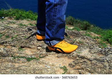 Men stay in Mountains footwear on the beautiful  sea view.