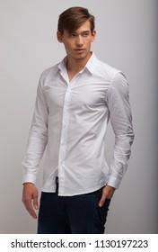 men  student at studio catalog in white shirt