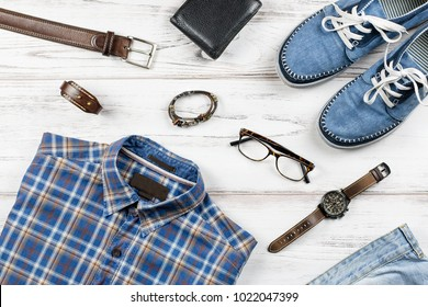 Men stylish casual clothing and accessories on wooden background.