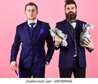 Men in suit, businessmen with jar full of cash and credit card, pink background. Mature man wants to put money into bank account, get credit card, electronic money. Bank account concept