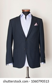 Men suit fashion. Dark blue jacket, white shirt and red point patterned pocket square