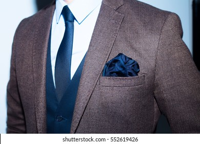 men suit perfect to the last detail.Man posing in brown suit