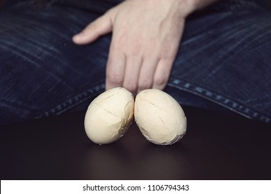 Men Testes - groin pain and lightning. The concept of disease in male testicles. Broken eggs are a symbol of problems with testicles in men.