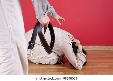 Men threadting and beating his wife at home with a belt