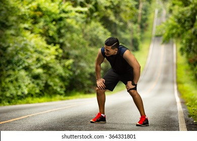 Men are tired From jogging on a steep slope