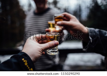 Men toast with brandy glass