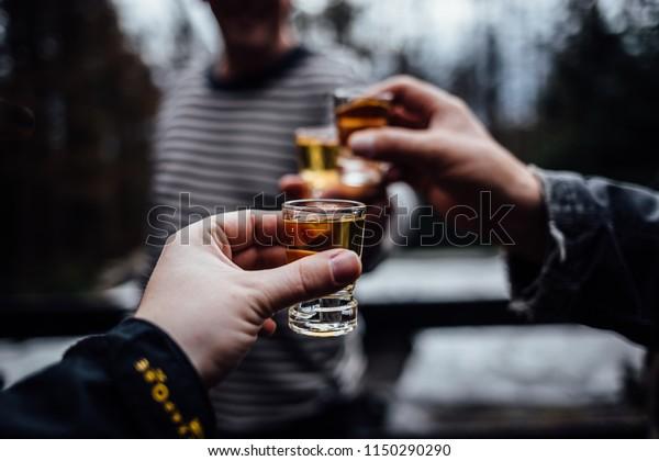 Men toast with brandy glass