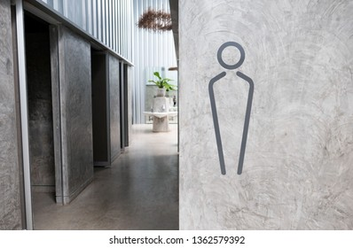 men toilet sign on gray wall background and copy space ,space for text or images .