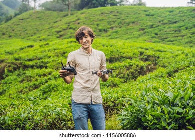 Men tourist tries to launch the drone at a tea plantation. Natural selected, Fresh tea leaves in tea farm in Cameron Highlands, Malaysia. Ecotourism concept