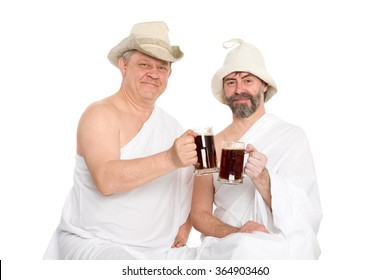 Men in traditional bathing attire drink kvas - russian bread juice. From a series of Russian bath.