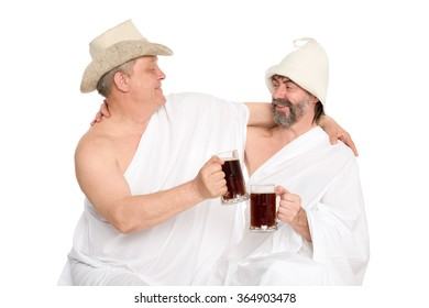 Men in traditional bathing costumes drink kvas - russian bread juice. From a series of Russian bath.