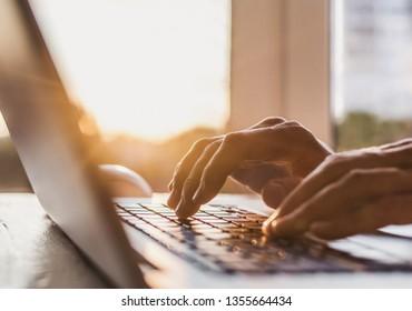 Men typing on computer keyboard. Businessman using laptop in the office. Online internet marketing concept. Freelance work