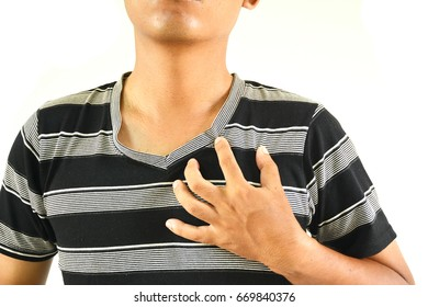 Men use the hand to the chest. Because of a heart attack.