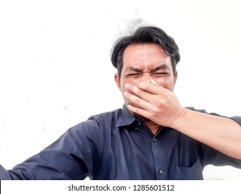 The men used a hand to mouth and noseProtect from dust to maintain health di cut on white background , blurred , soft focus.