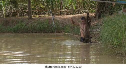 Men are using fishing equipment in ponds.Mahasarakham,Thailand,October 2016