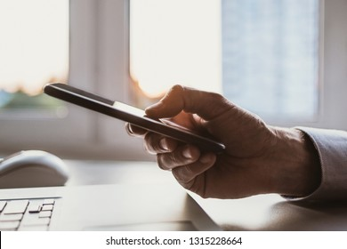 Men using smart phone and smartphone. Businessman  texting on phone in the office