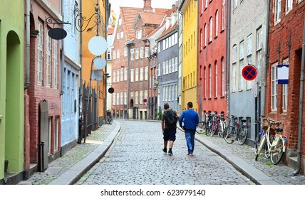 Men Walking Down Colourful Avenue of Old Town Copenhagen - September 2015 - Copenhagen, Denmark