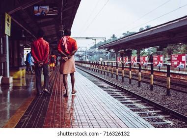 Men walking through a railway station in India