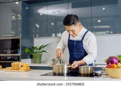 Men warm boiled food soup interior kitchen background