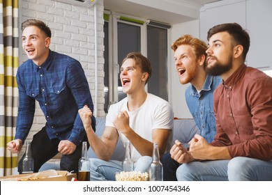 Men watching sport on tv together at home team won
