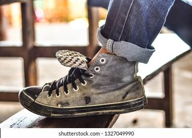 Men wear old sneakers to work.