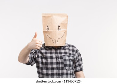 Men wearing funny paper mask with thumb up and bitcoin symbol