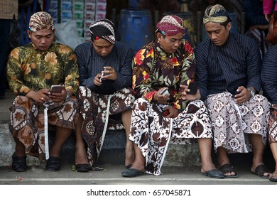 Men are wearing Javanese Clothes Beskap and Blangkon during ceremony of Wonosari District Anniversary in 27th May 2014