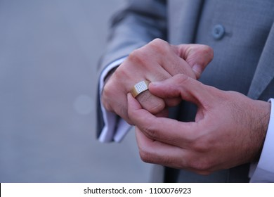 men wearing a wedding ring in his hand.