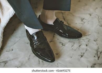 Men wearing work black boot. returning to the house.
